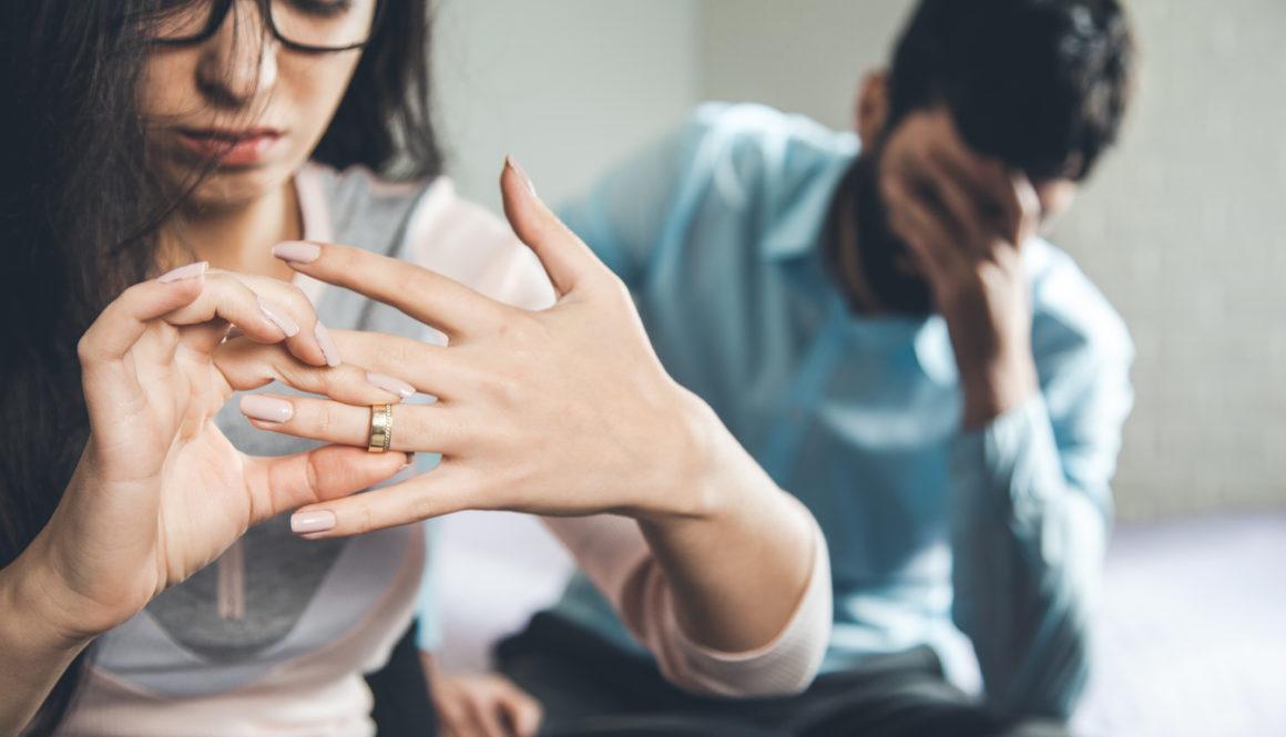 sad woman hand ring with sad man